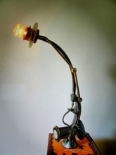Steampunk desk or dresser lamp: Armcarbon filament lamphourglass and and cable dimmer.