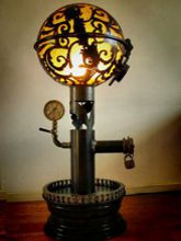 Steampunk Art floor lamp: Decorative piece of art with skulls and flowers.
