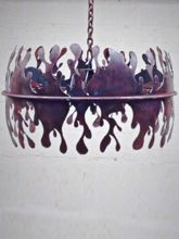 Pendant Light with the inverse of flames.