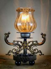 Steampunk desk or dresser lamp: small steampunk lamp with Armcarbon filament lamphourglass and and cable dimmer.