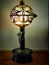 Steampunk Art floor lamp: Decorative piece of art with a Phoenix and Ace of Spades design design.