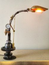 Steampunk  desk or dresser lamp: with Armcarbon filament lamphourglass and and cable dimmer.