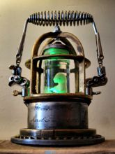 Steampunk Art Alchemy lamp for sale: Decorative piece of art with taxidermy fetus of a kitten.